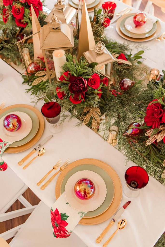 Christmas table with red ornaments and poinsettia napkins