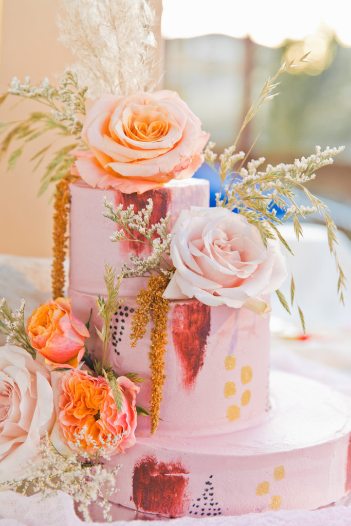bohemian birthday cake topped with roses