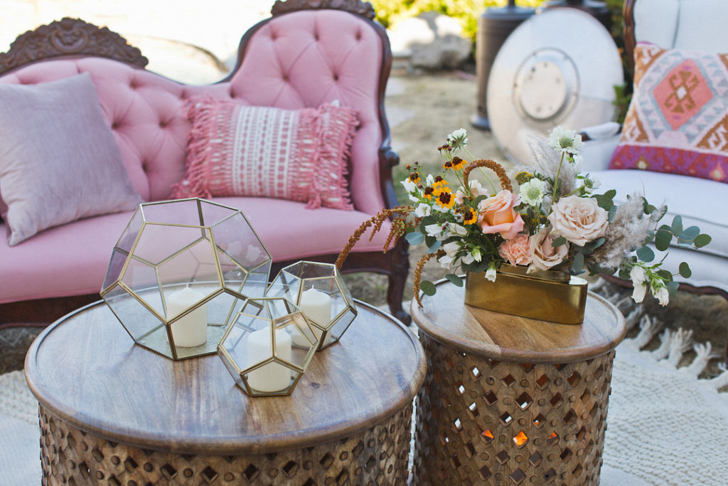 bohemian themed outdoor seating area at party