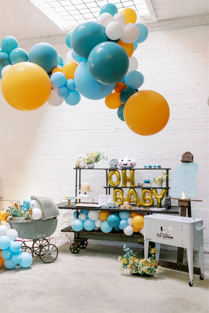 baby shower dessert table with balloon arch