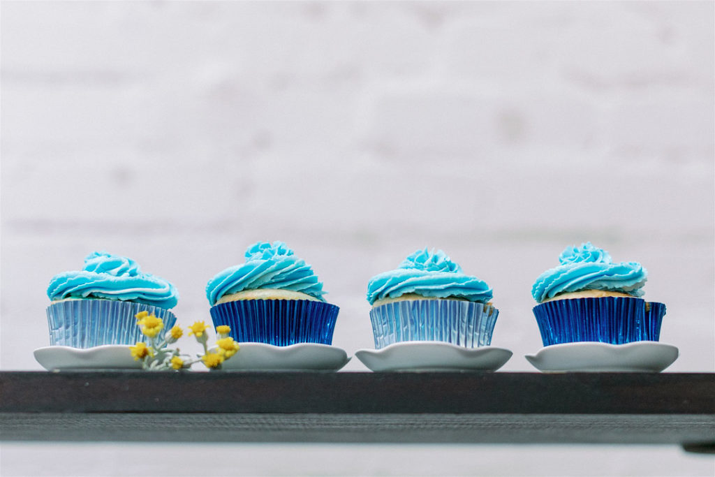 blue cupcakes at a baby shower
