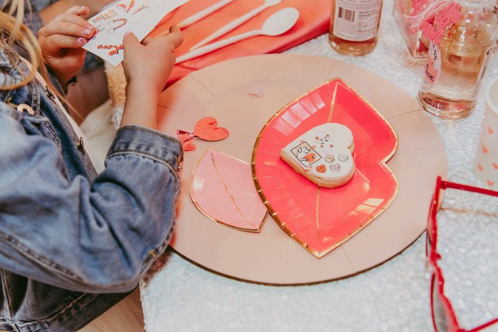 decorating valentine's sugar cookies with edible stickers