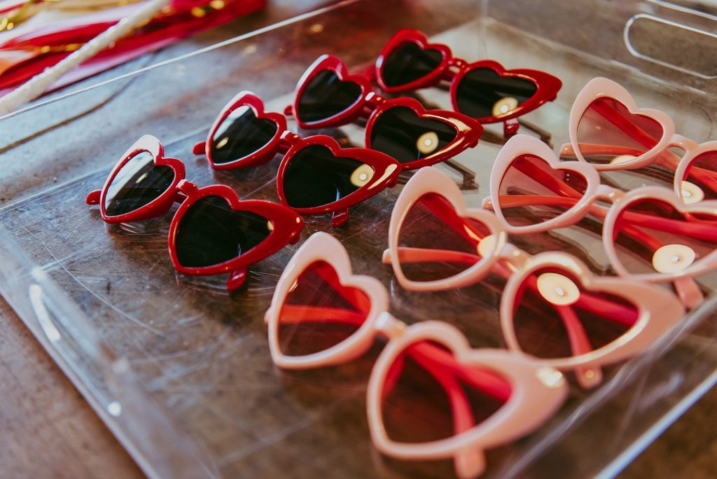 red and pink heart shaped sunglasses on a tray
