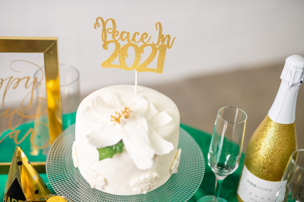 New Year's Day cake with peace lily topper