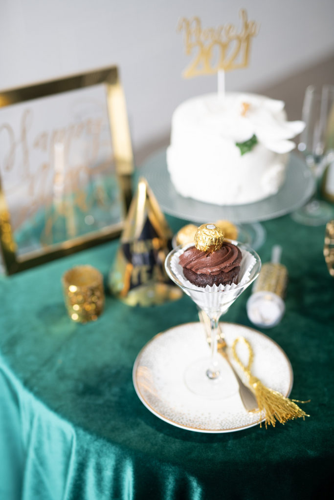 chocolate cupcake in martini glass at new year's eve party