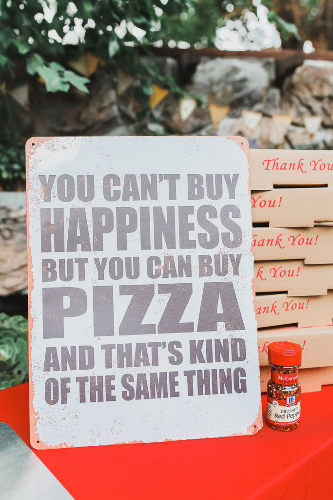 funny pizza sign at pizza party