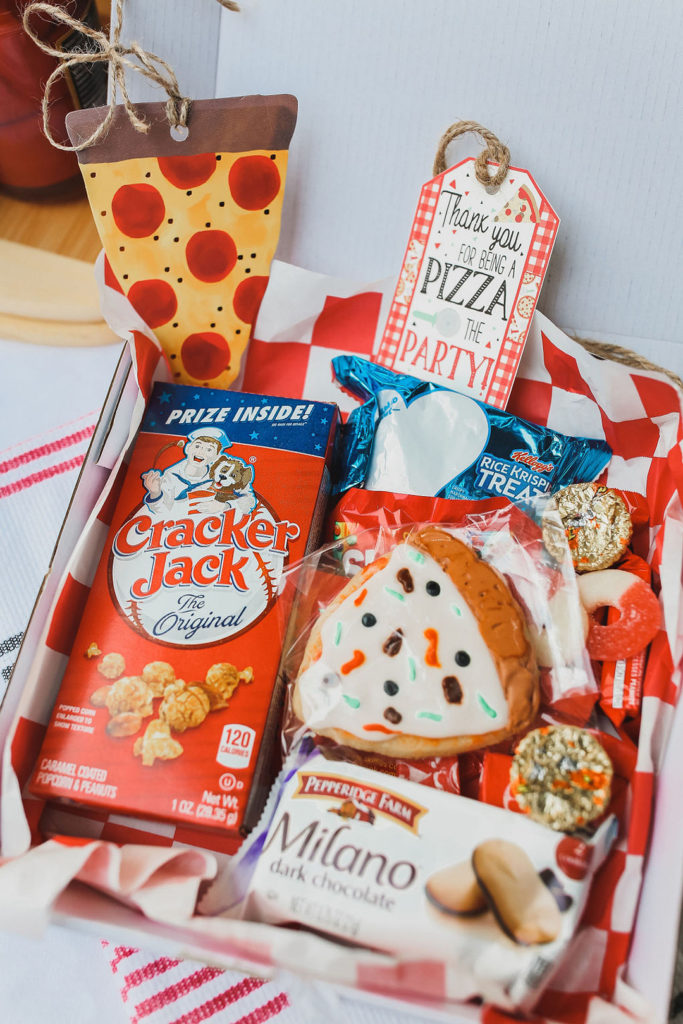 pizza shaped cookies and candy in party favor box
