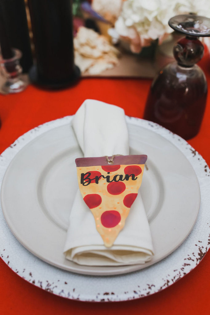 pizza party place setting with pizza shaped name card