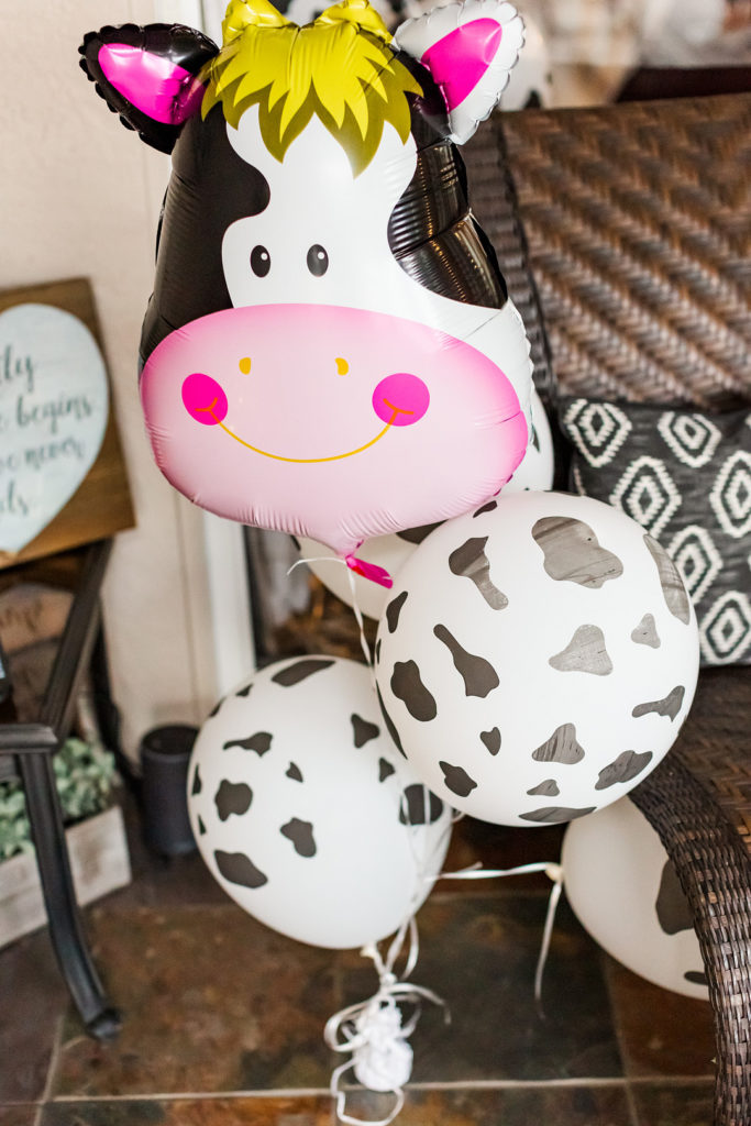 cow print balloons at 1st birthday party