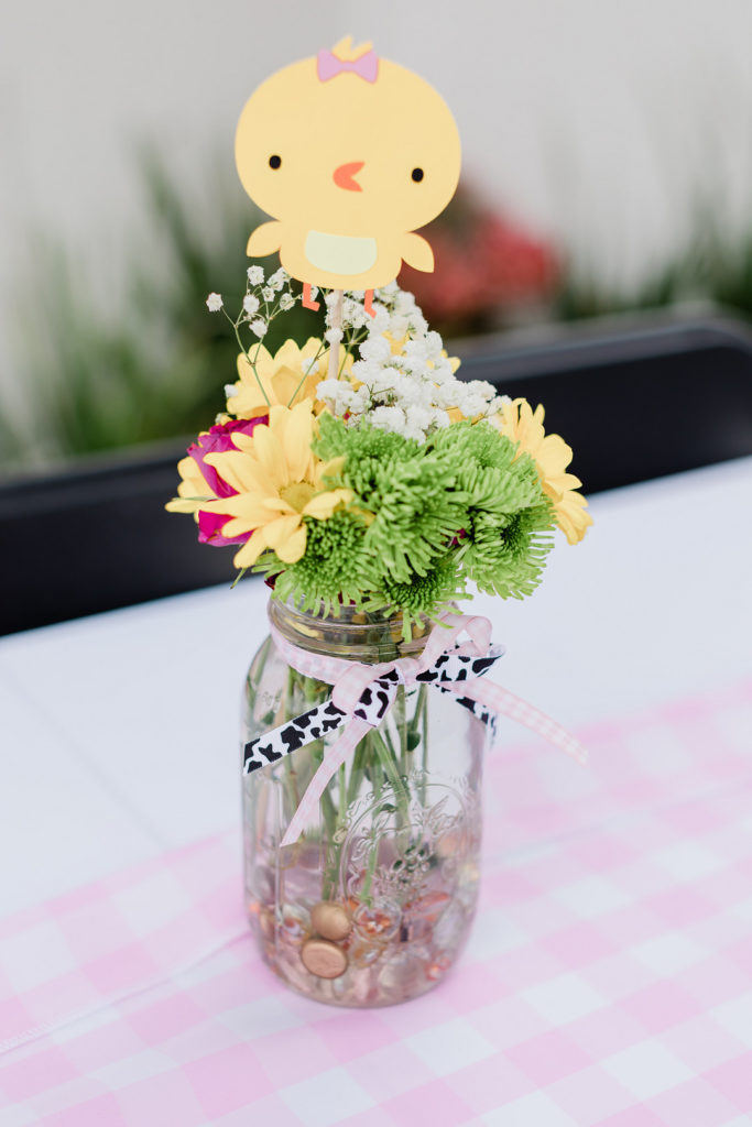 floral centerpiece at barnyard first birthday party