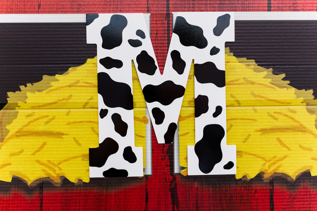 cow print letter M on barn