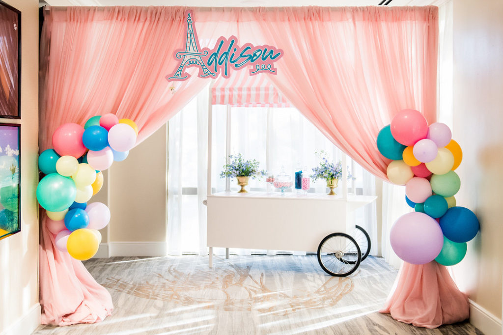 Paris themed party entry with curtains and balloons