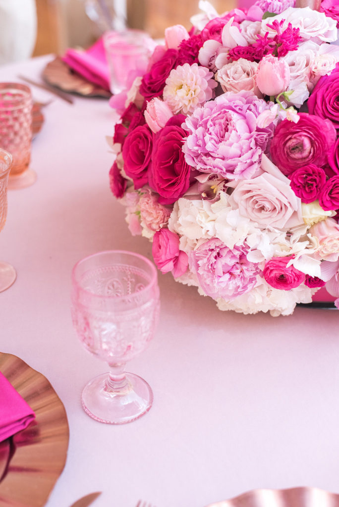 pink and white floral centerpiece at baby shower