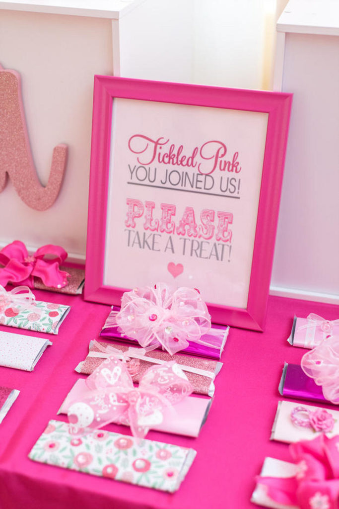tickled pink sign and chocolate party favors