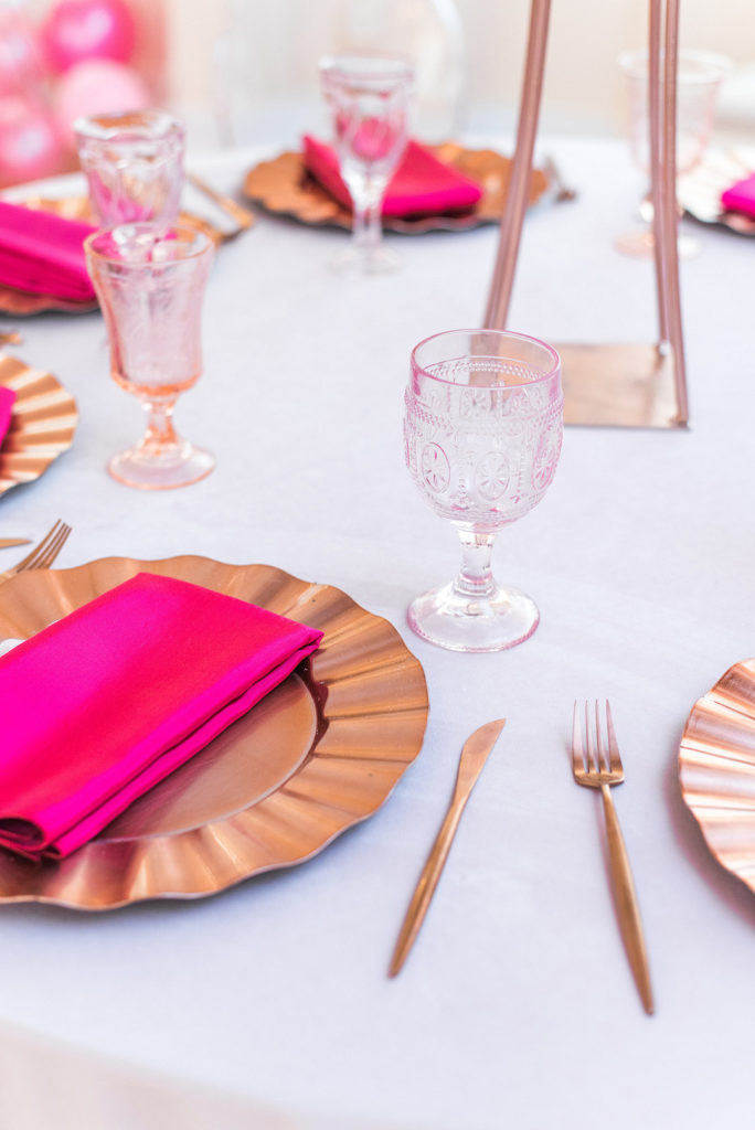 rose gold and hot pink place setting at baby shower