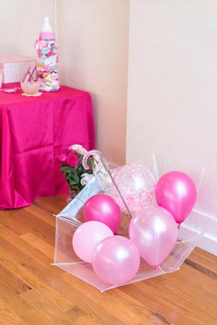 pink umbrella at girl's baby shower