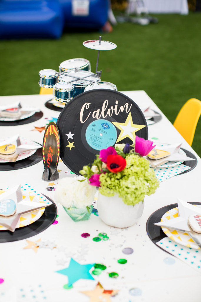 rock and roll themed centerpiece with record at birthday party