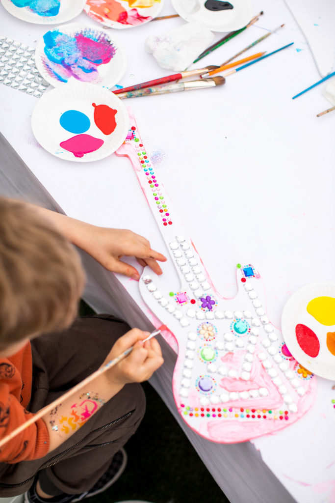wooden guitar craft activity at birthday party
