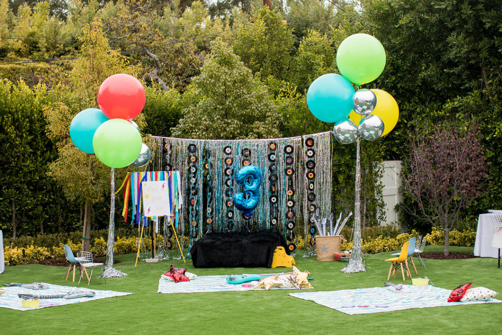 3rd birthday rock and roll photo booth with balloons
