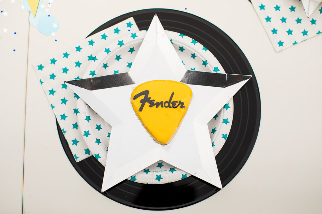 silver star plate on top of record for rock and roll place setting