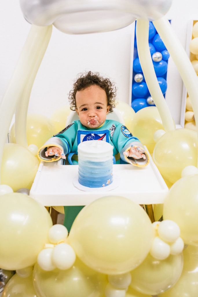 one year old eating smash cake