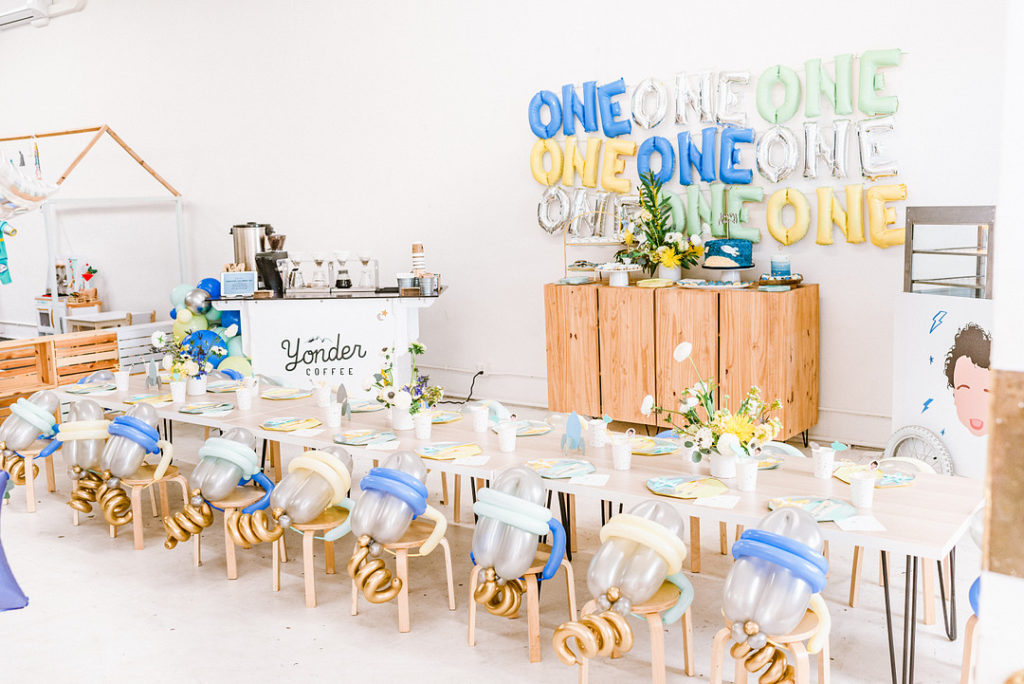 space themed first birthday party setup