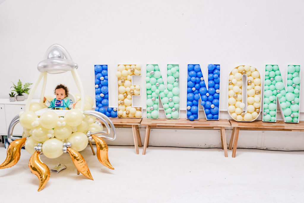 balloon rocket ship photo booth at first birthday party