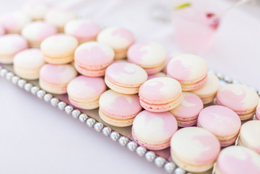 pink macarons on silver tray