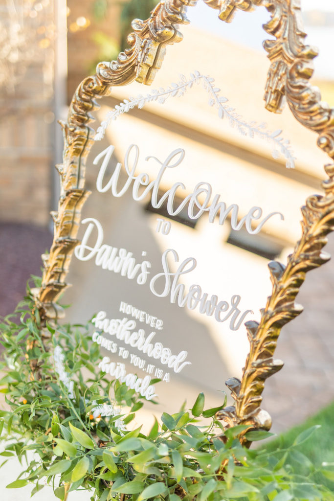 gold mirror welcome sign at adoption shower