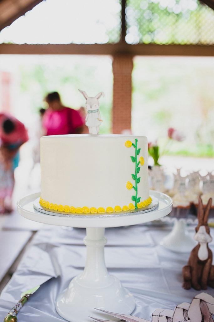 white birthday cake with bunny cake topper