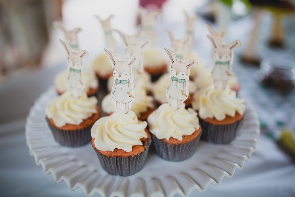 frosted white cupcakes with bunny cupcake toppers