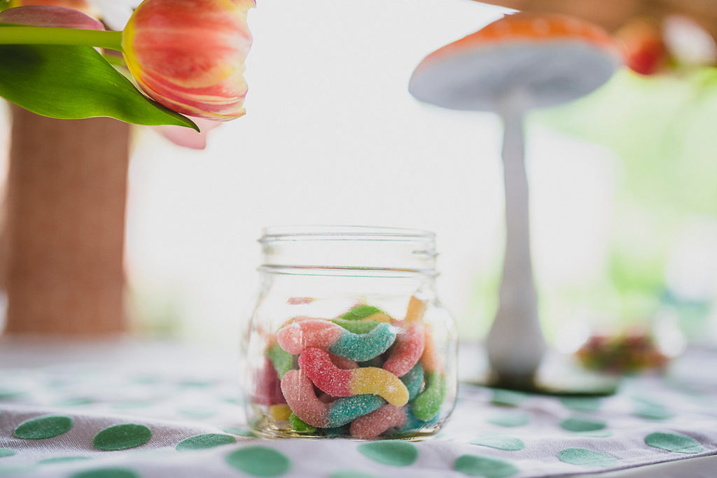 gummy worms in glass jar at birthday party