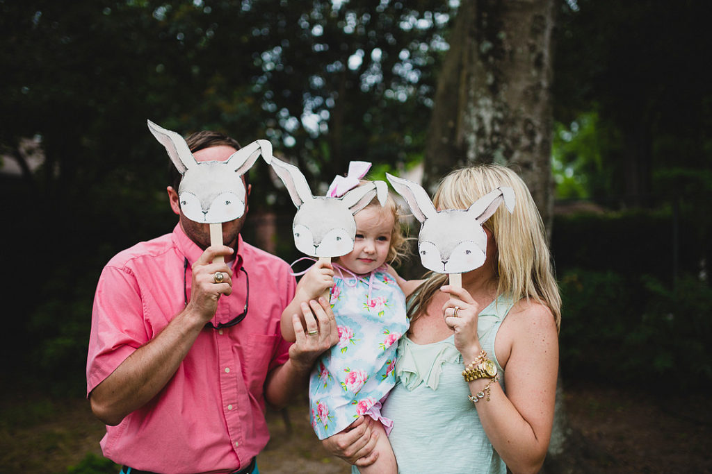 family with bunny masks at second birthday party