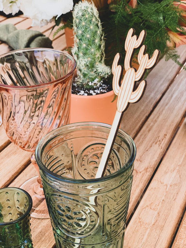 cactus stir stick in green glass