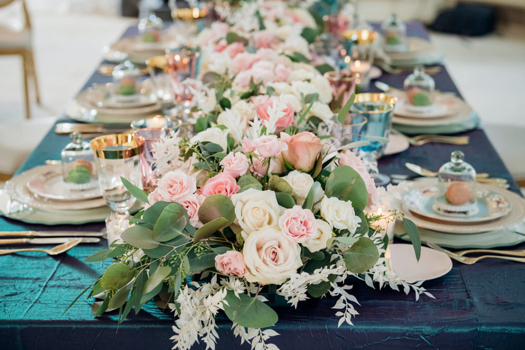 pink and white rose centerpiece on Easter table