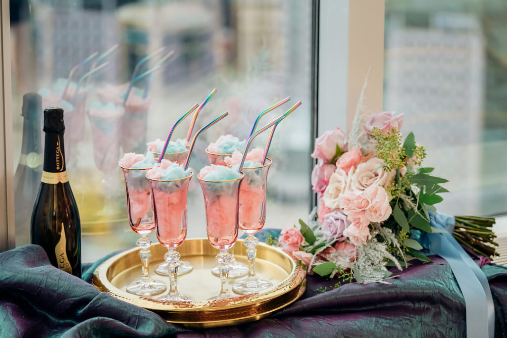 champagne cocktails on gold tray with cotton candy for Easter brunch