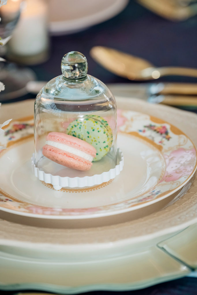 mini cloche with macarons on Easter place setting