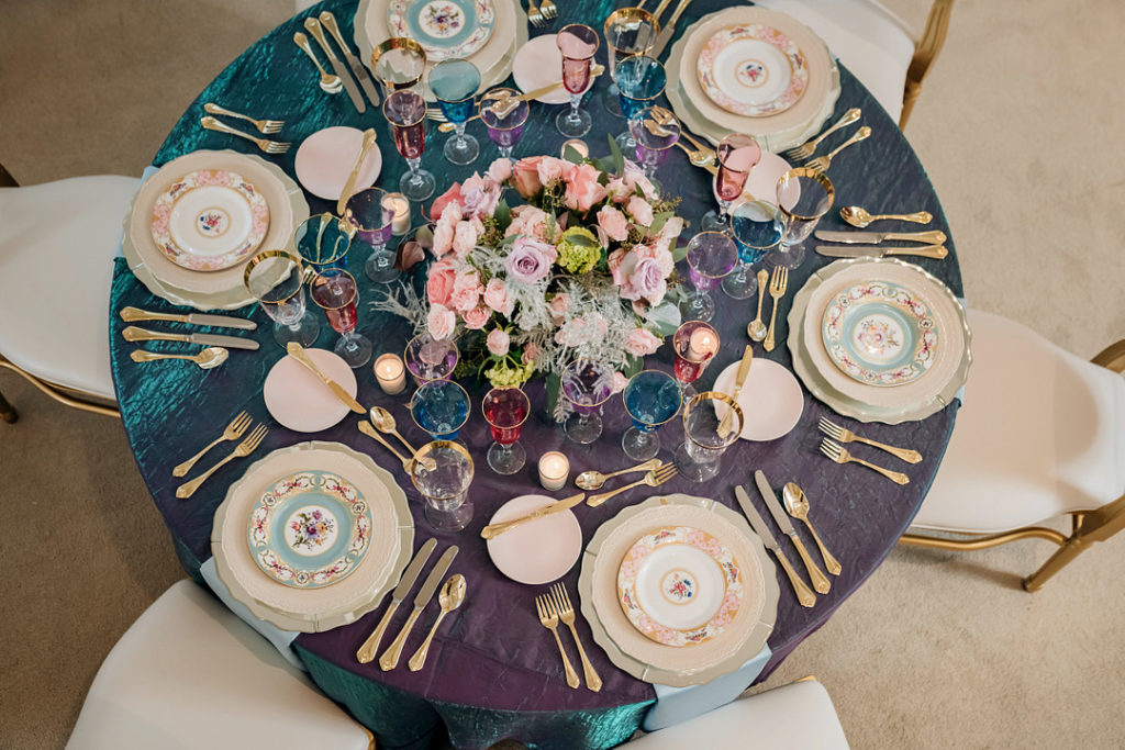 rose floral centerpiece on pastel Easter table