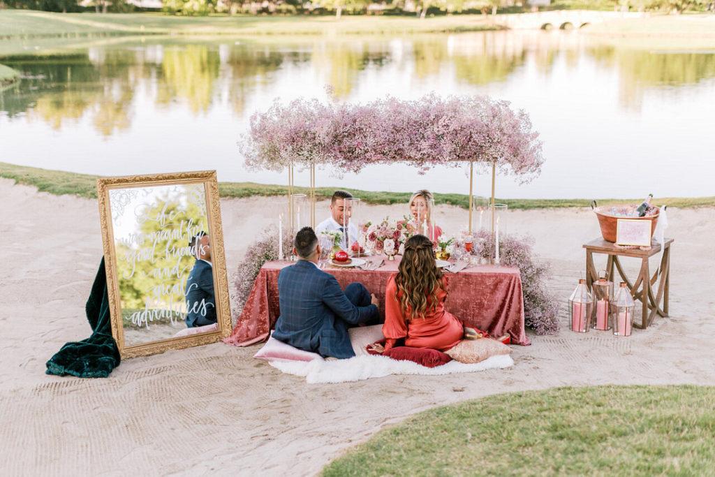 adult picnic by lake