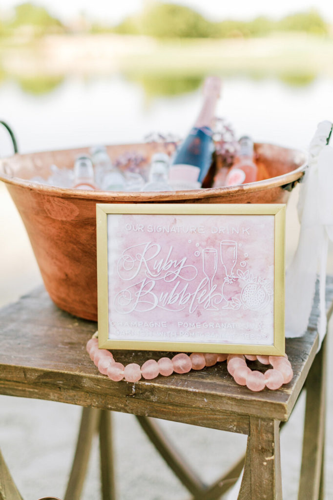 copper ice bucket with champagne and signature drink sign