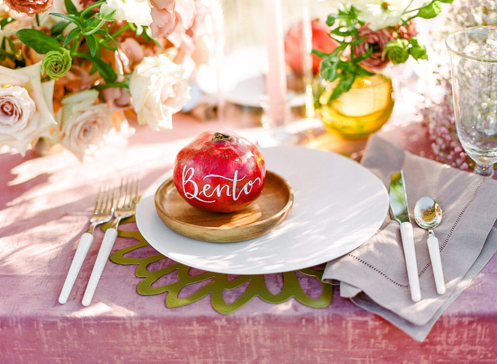 pomegranate name card at place setting