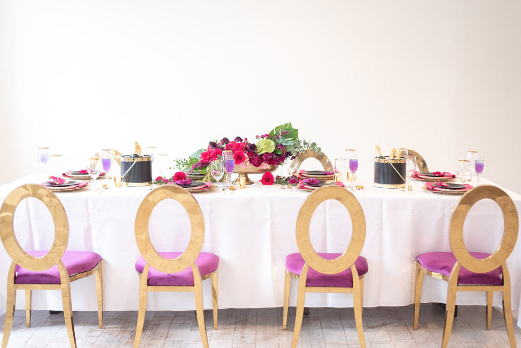 gold and pink chairs at tropical themed party