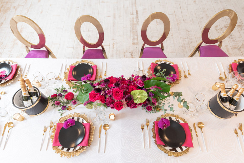 tropical tablescape in black white and pink